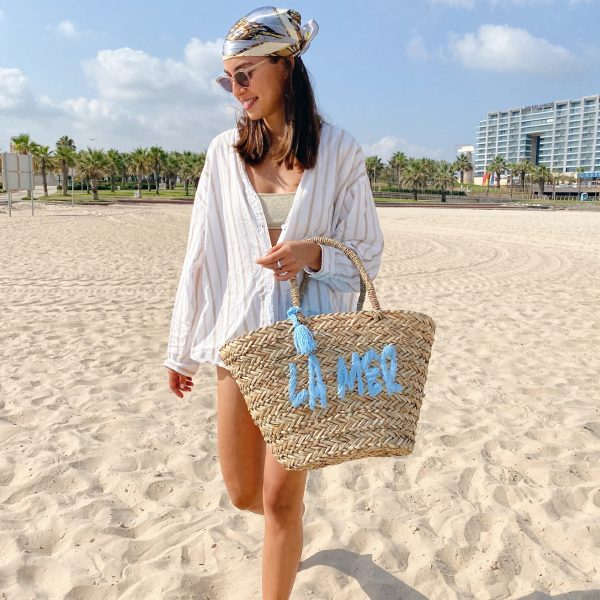 light blue embroidered straw bag